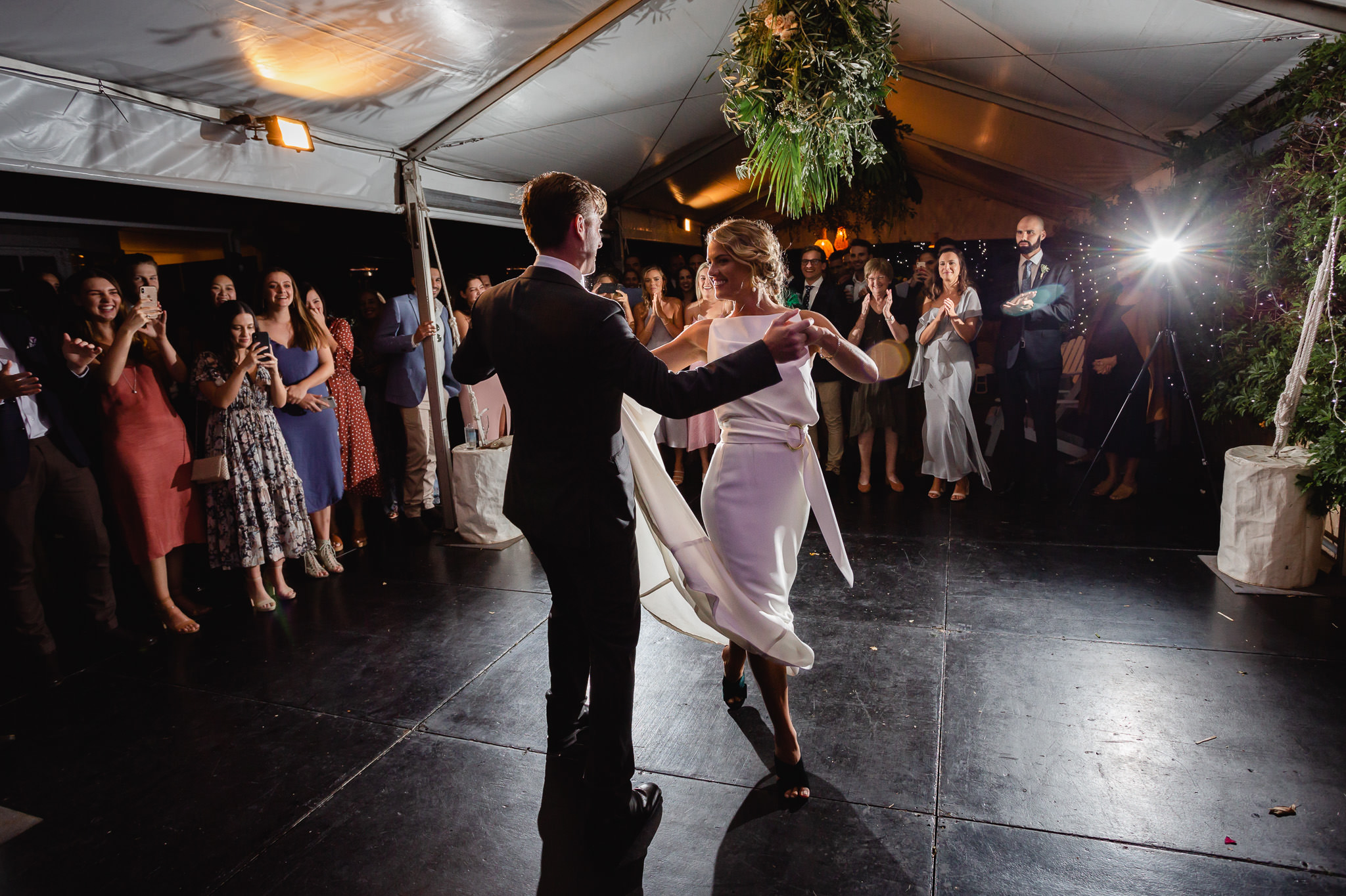 photo of first dance at backyard wedding under a marquee