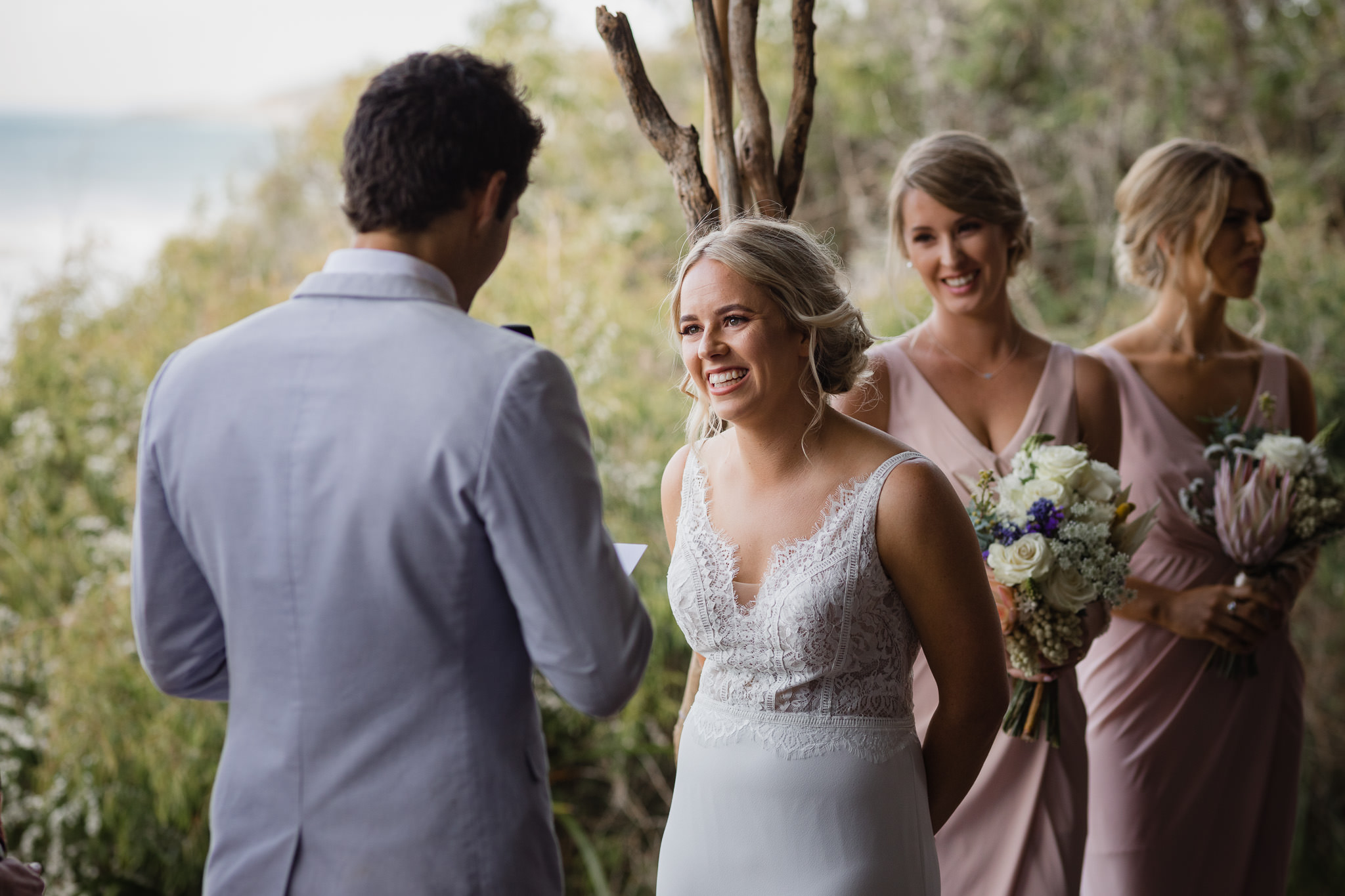 bride laughing during ceremony on deck at Bunkers Beach House cafe