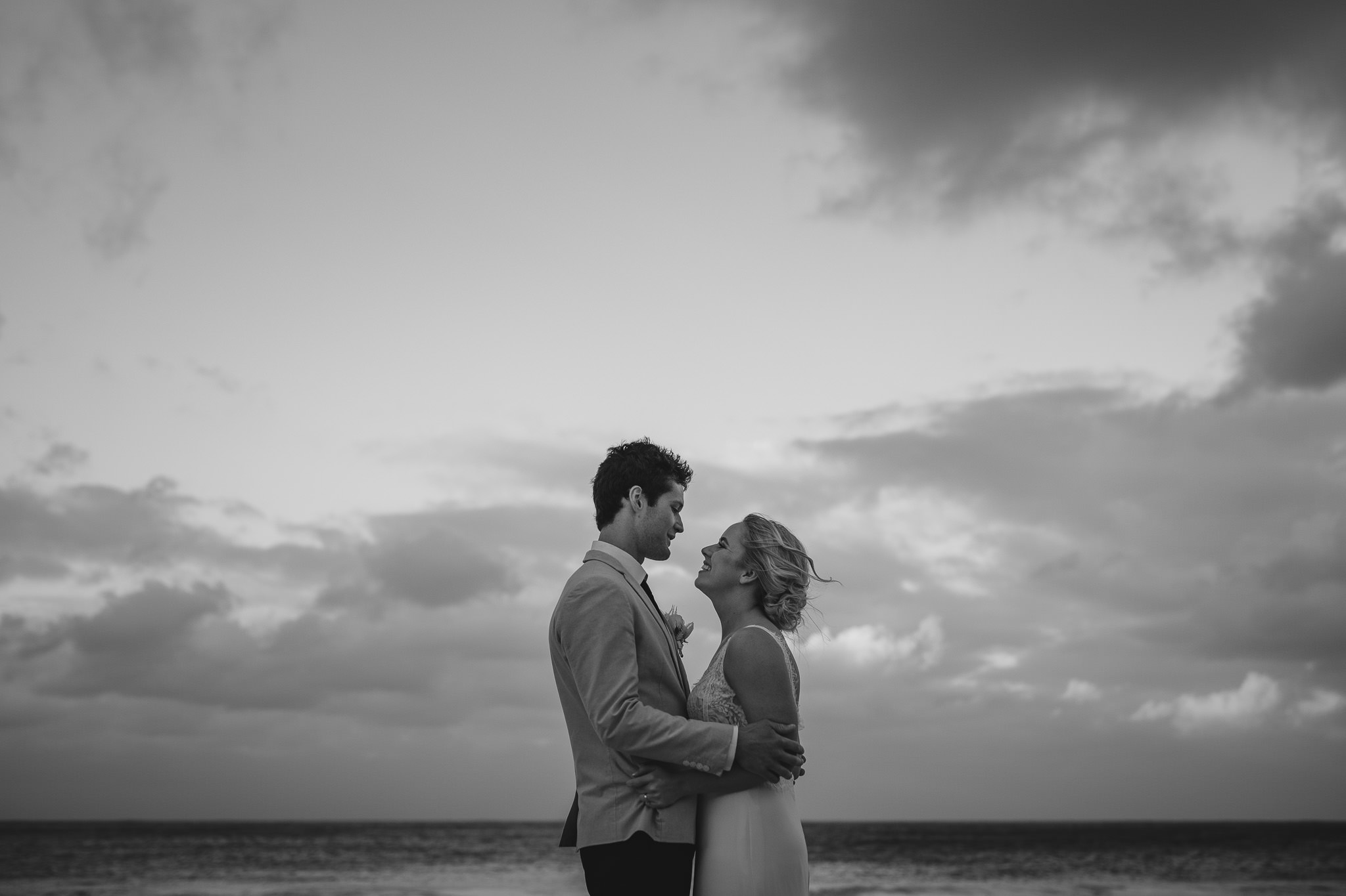 black and white photos of bride and groom under cloudy sky at Bunker Bay, near Dunsborough