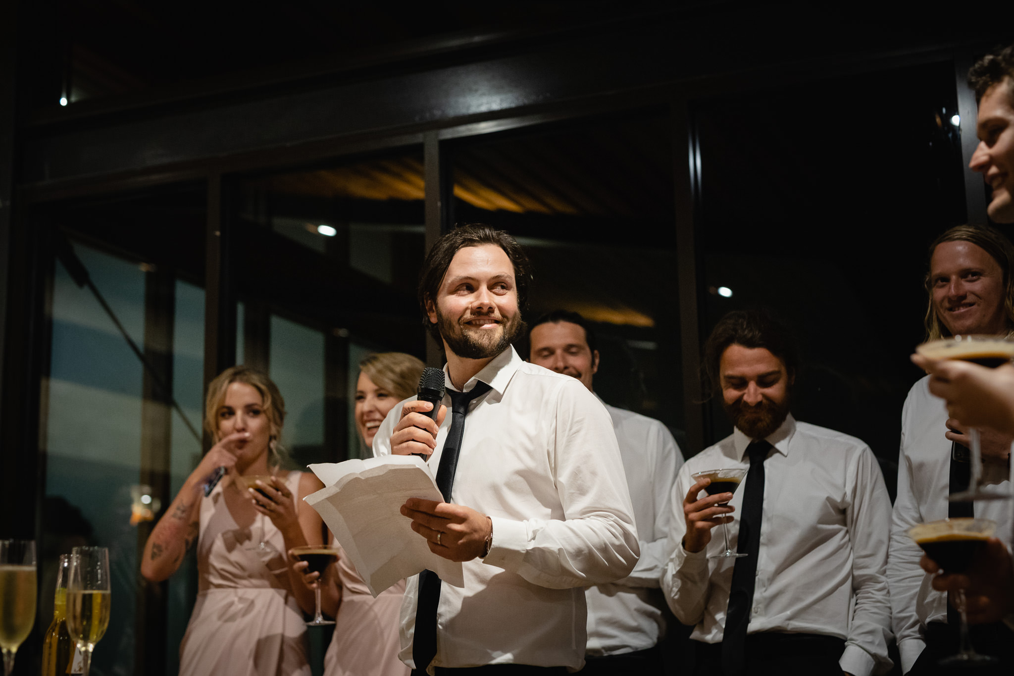 groomsman delivering speech at wedding reception at Bunkers Beach House