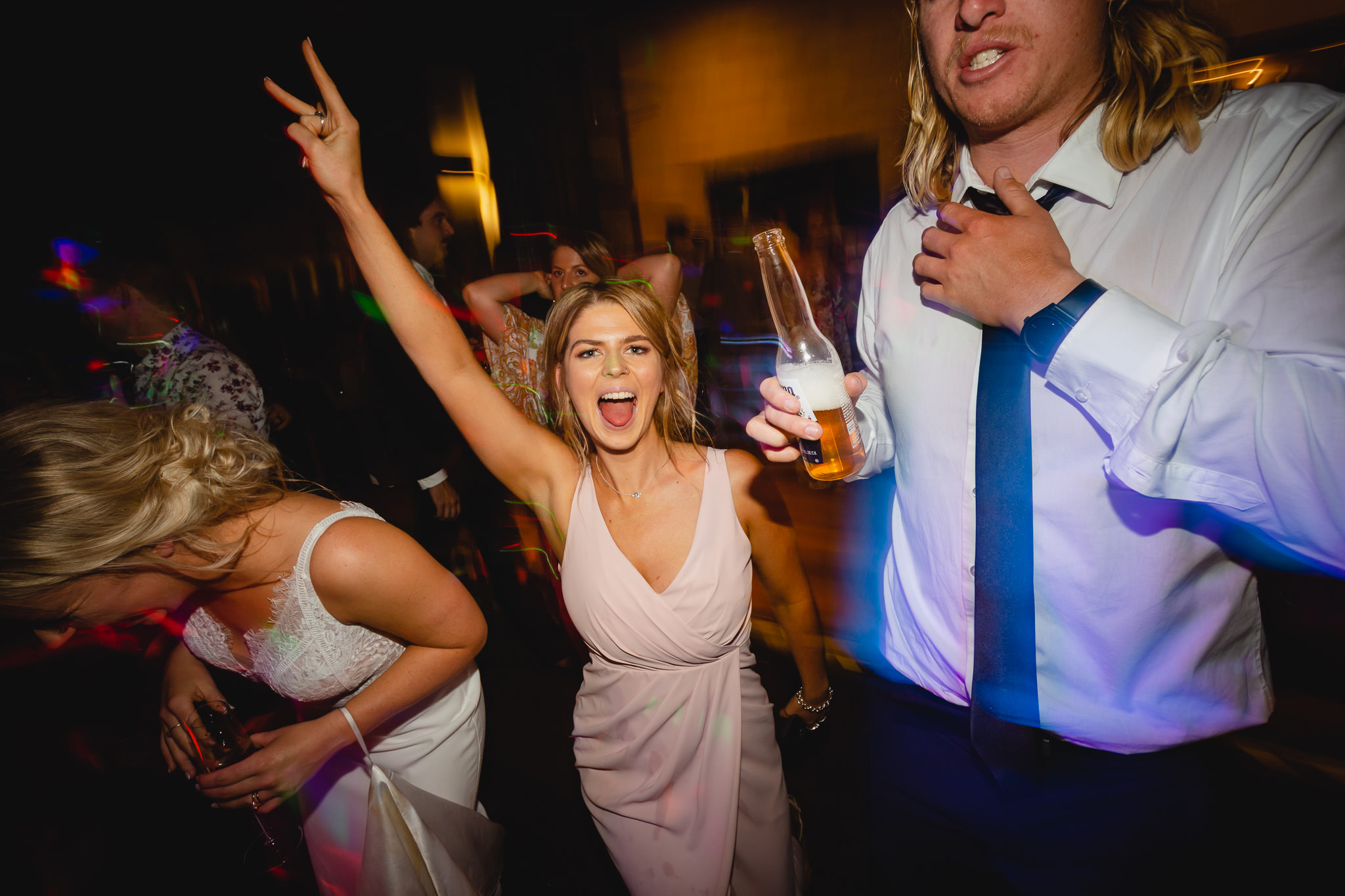 bridesmaid partying on dance floor at Bunker Bay cafe