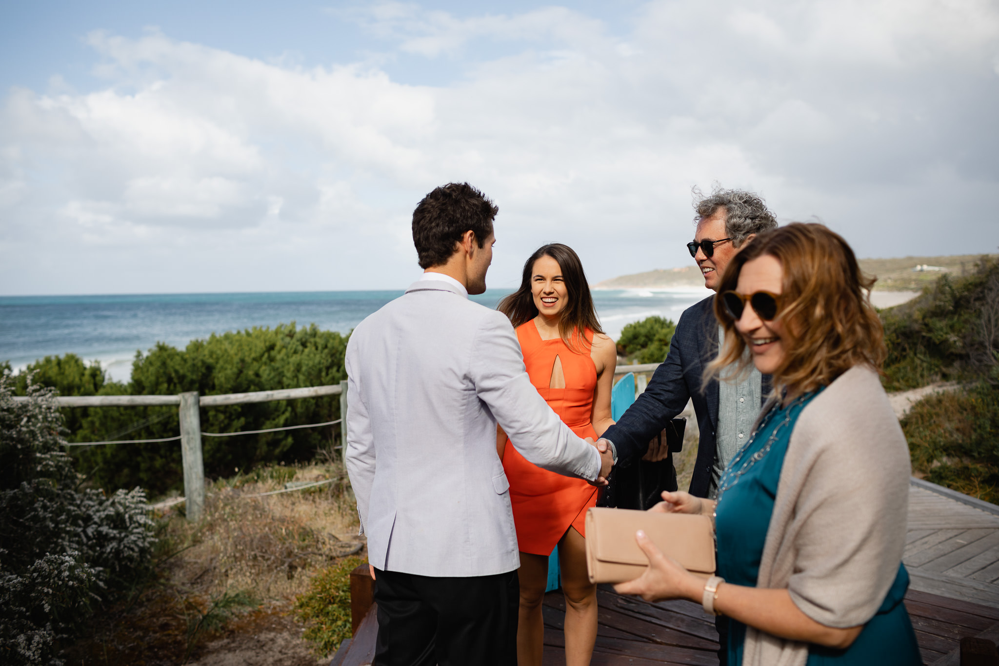 guests greeting groom before wedding ceremony at Bunker Beach House