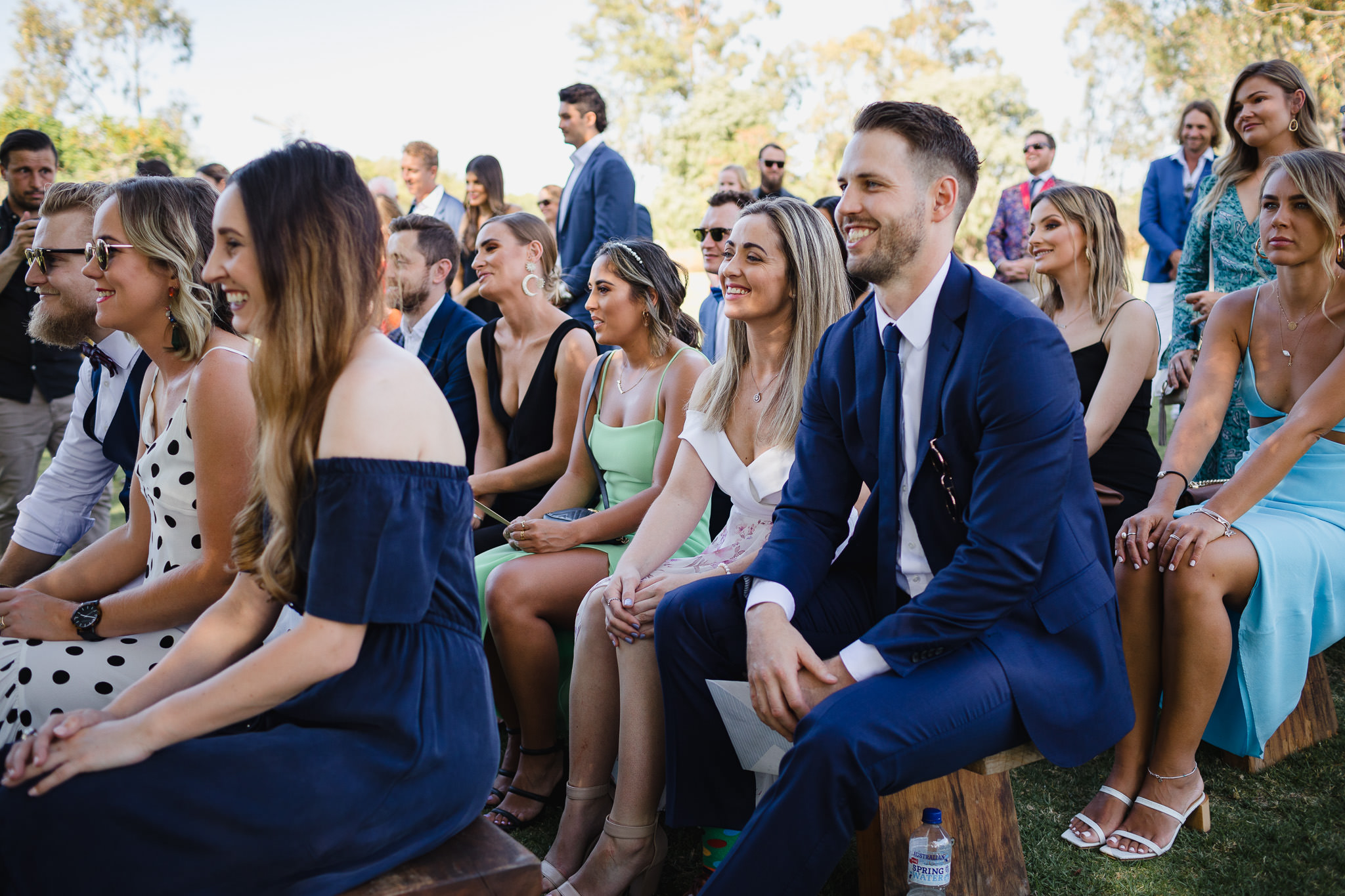 wedding guests laughing at outdoor wedding ceremony