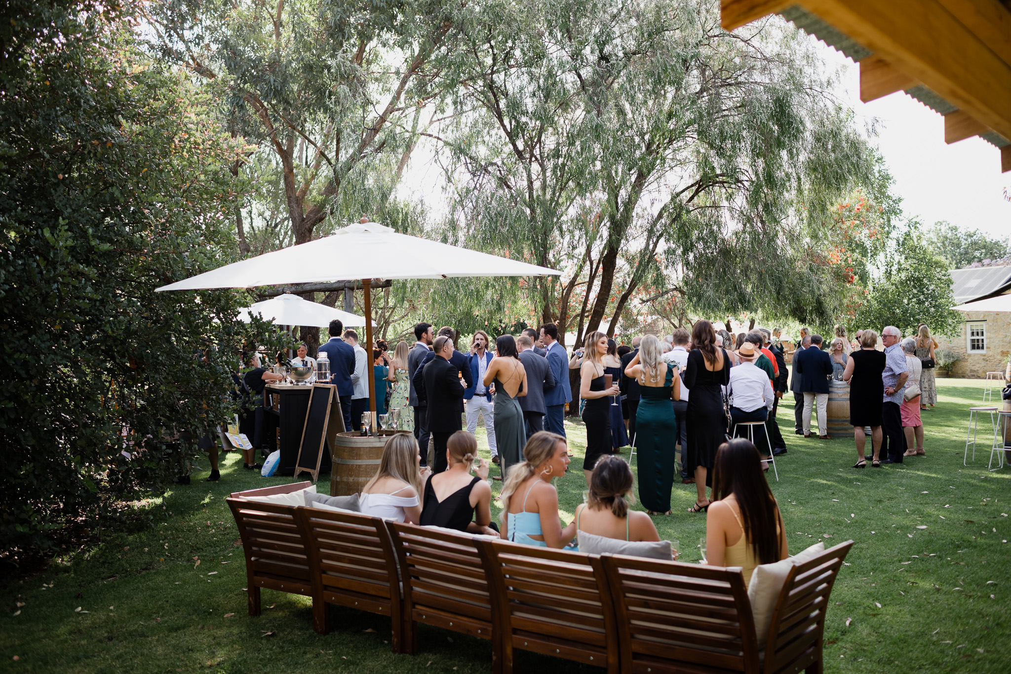 garden wedding party at Old Broadwater Farm with bar, furniture and peppermint trees