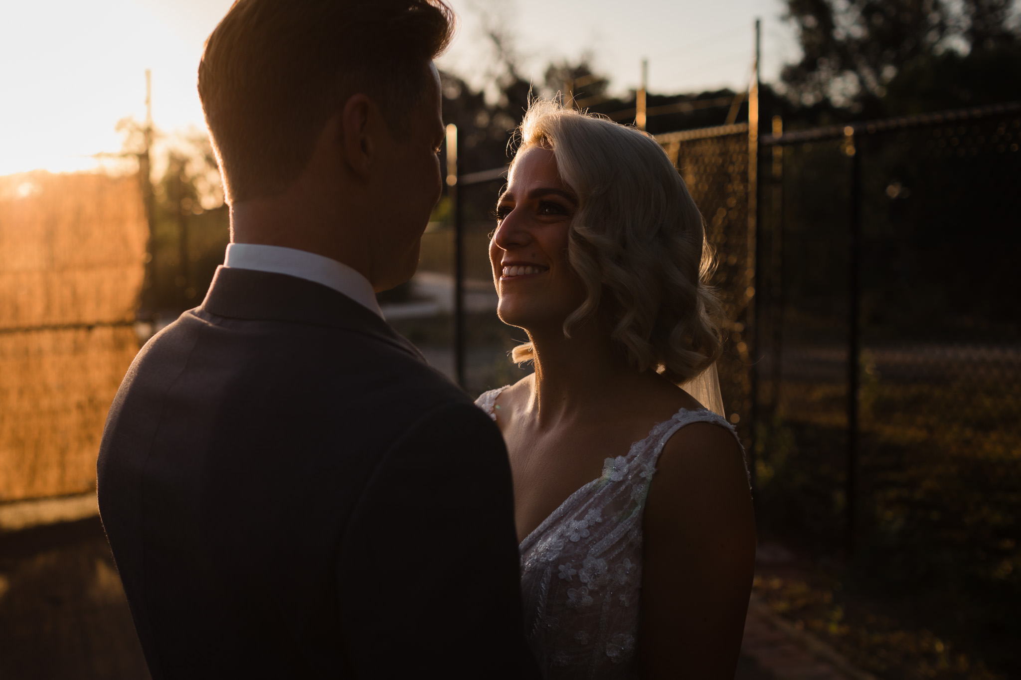 close up photos of bride and groom at sunset with golden light at Old Broadwater Farm