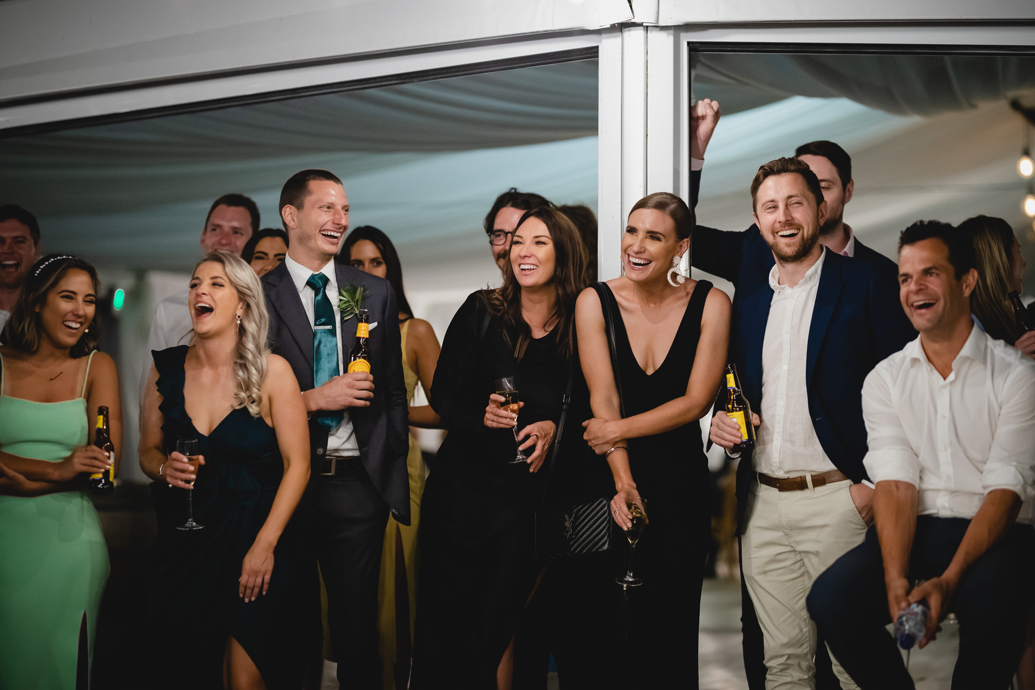 group of guests laughing during wedding speeches in Busselton