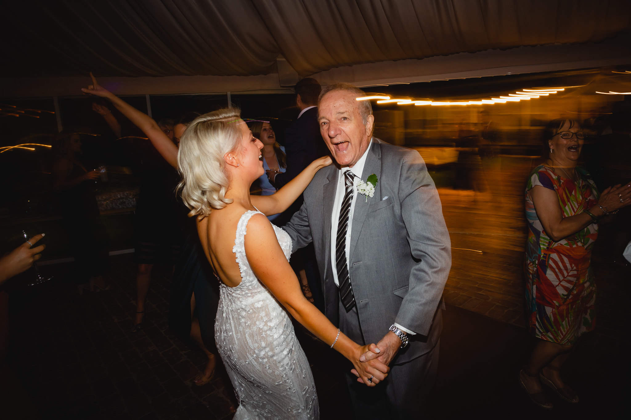bride dancing with granddad at wedding reception