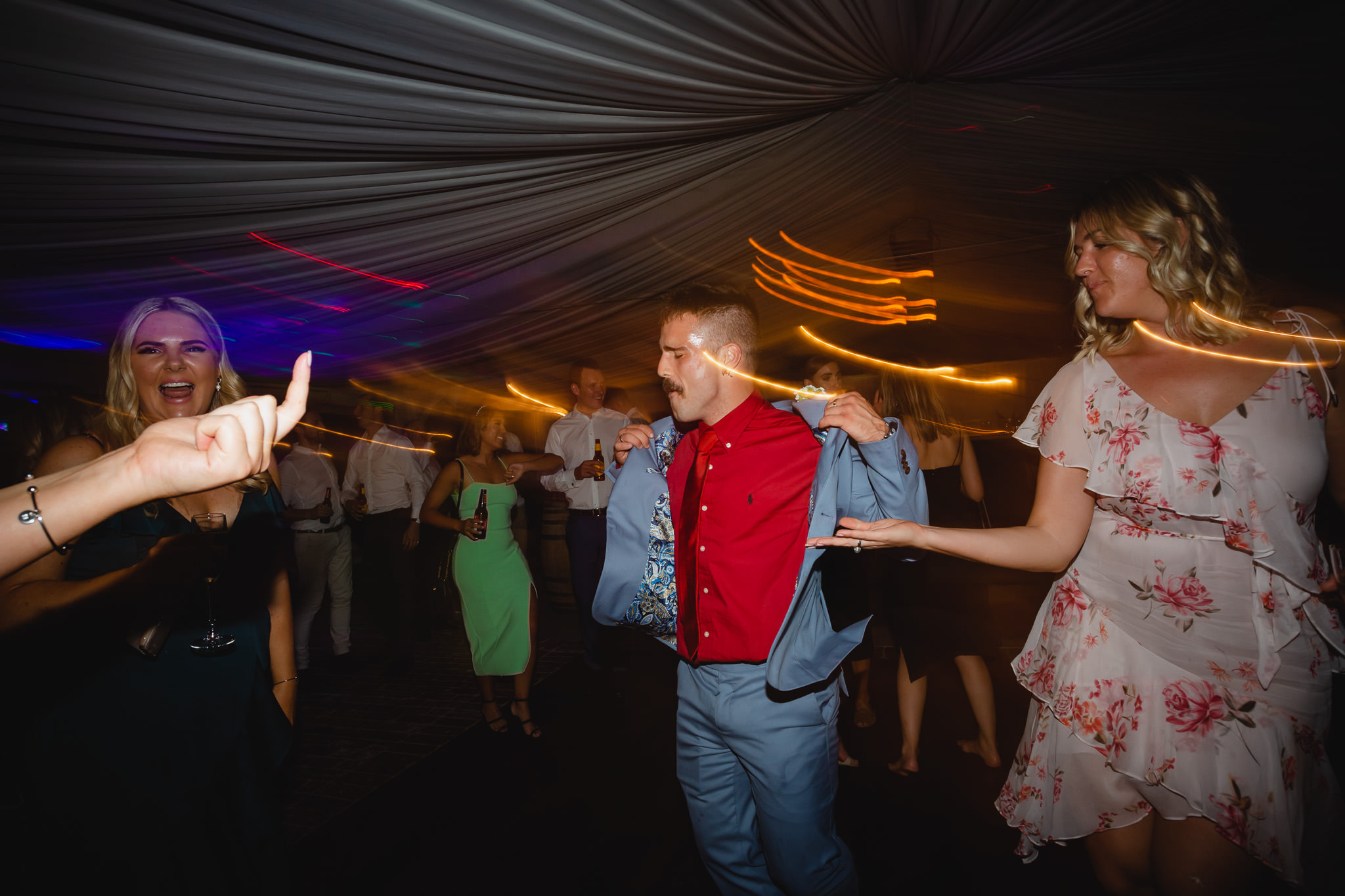party photo of guests dancing at wedding reception