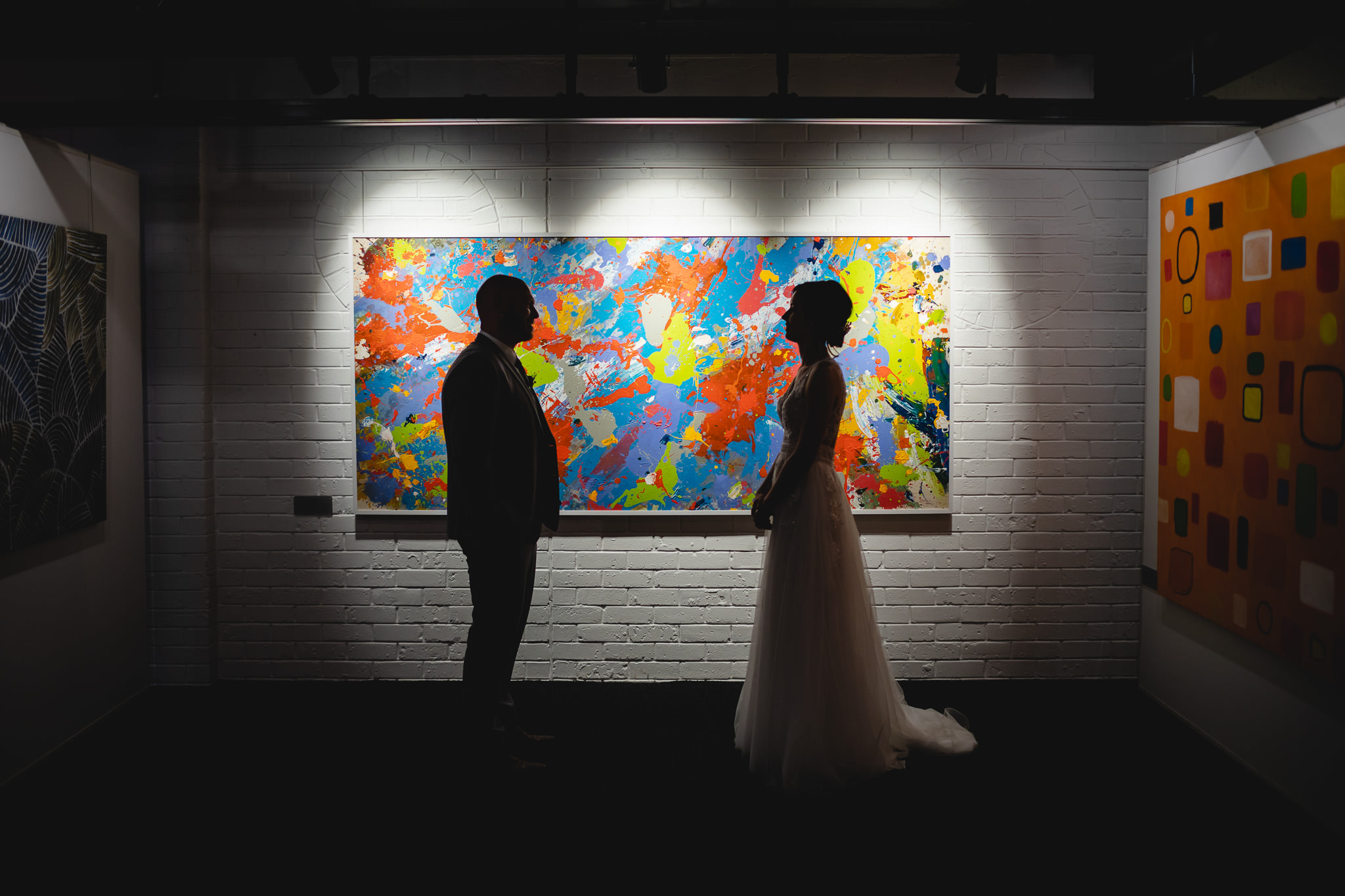 Bride and groom posing in art gallery at Leeuwin Estate on their wedding day