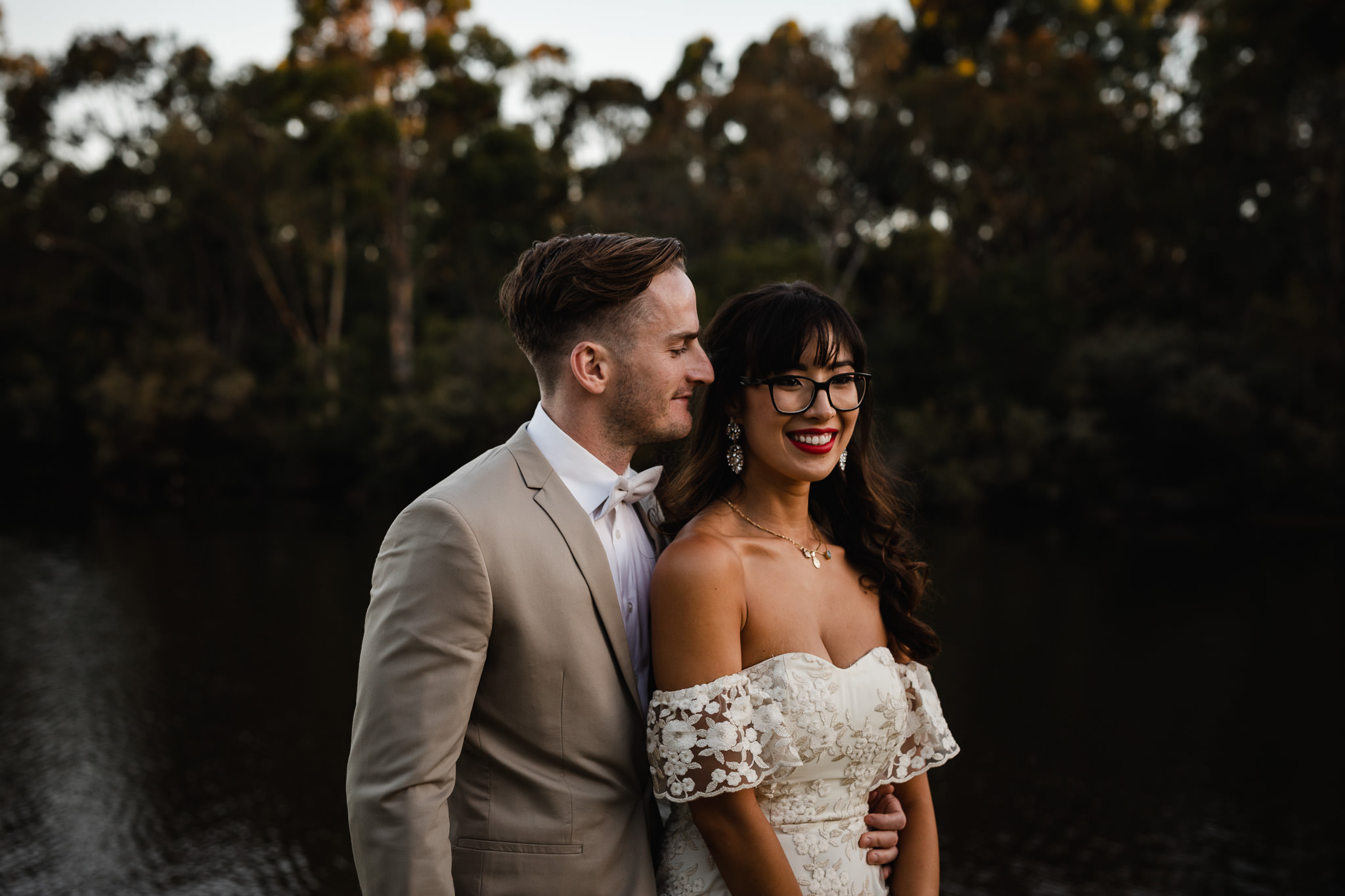 Bride and groom standing in front of dam and lake at Eight Willows Retreat in MargaretRiver on their wedding day
