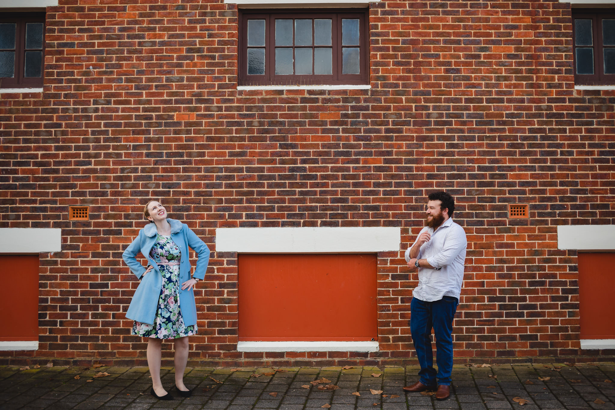 Couple with vintage style quirky posing in front of historic red brick building in Guildford, Western Australia