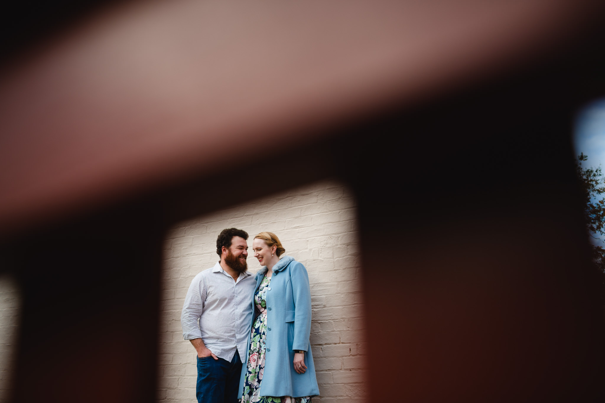 couple with vintage style with woman in blue coast and floral dress