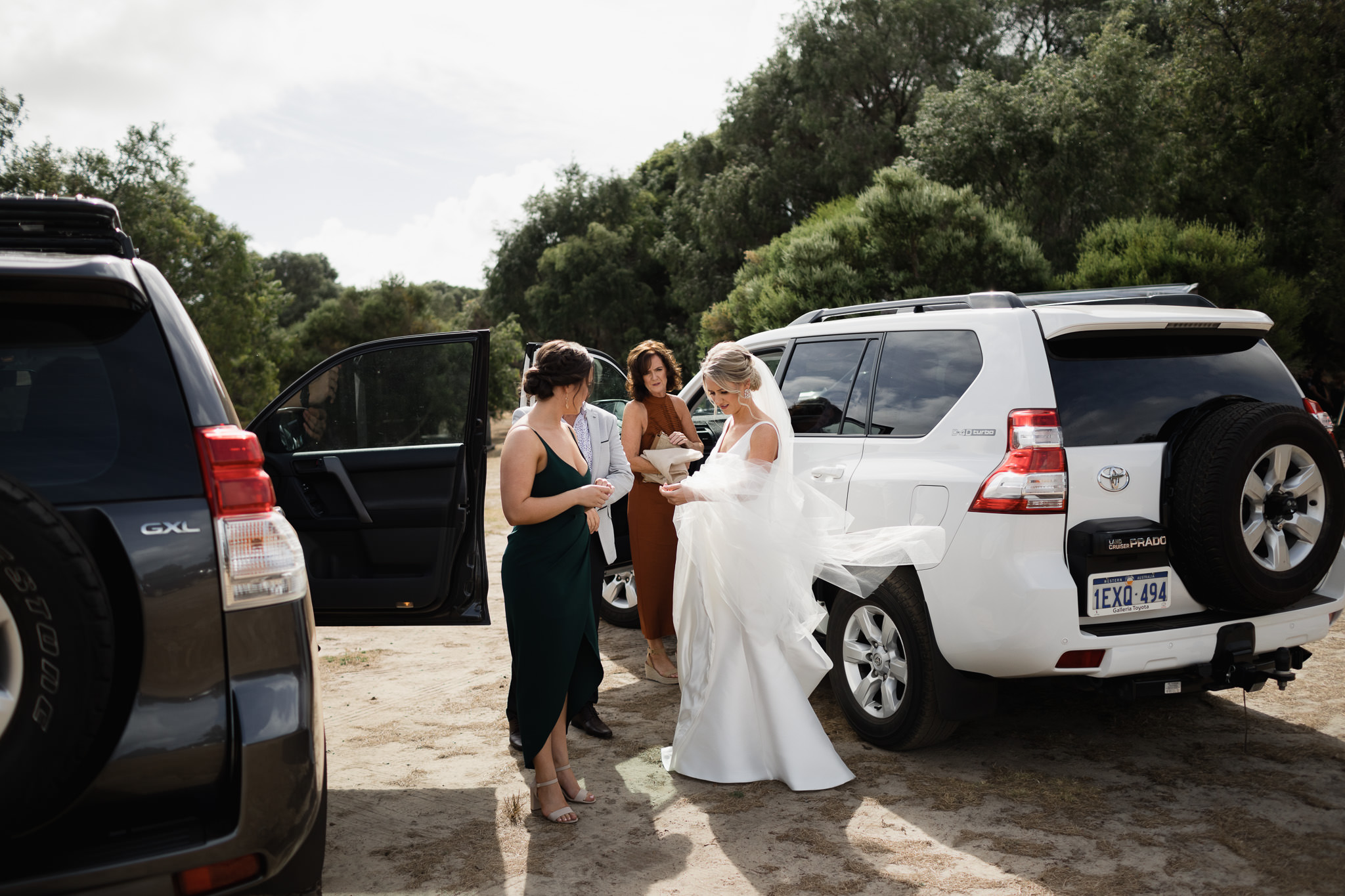 Bride and family arriving at wedding ceremony at Solitaire Homestead in Yallingup in Toyota Prado four wheel drive cars