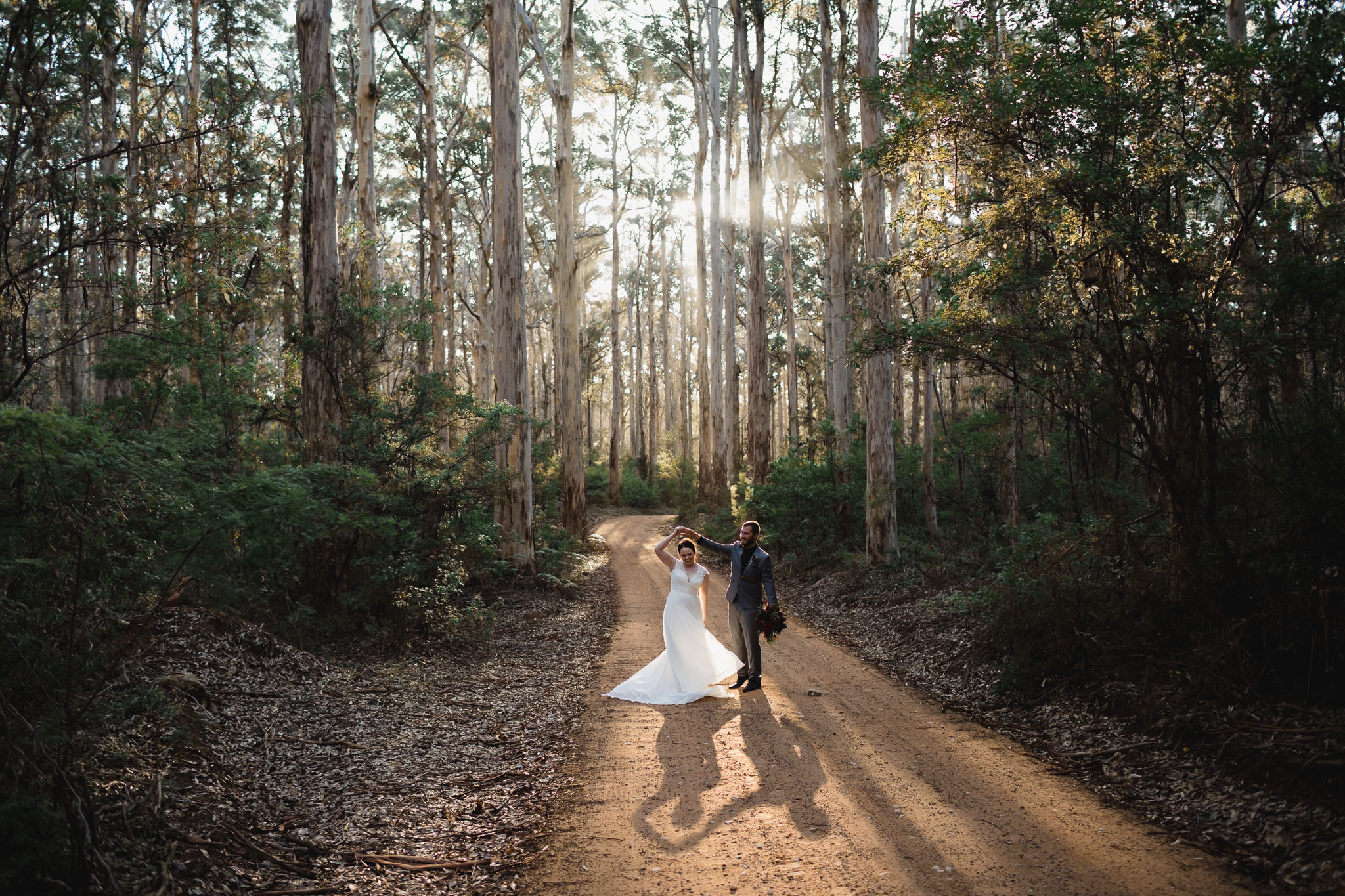groom spinning bride as she dances at their Boranup forest elopement