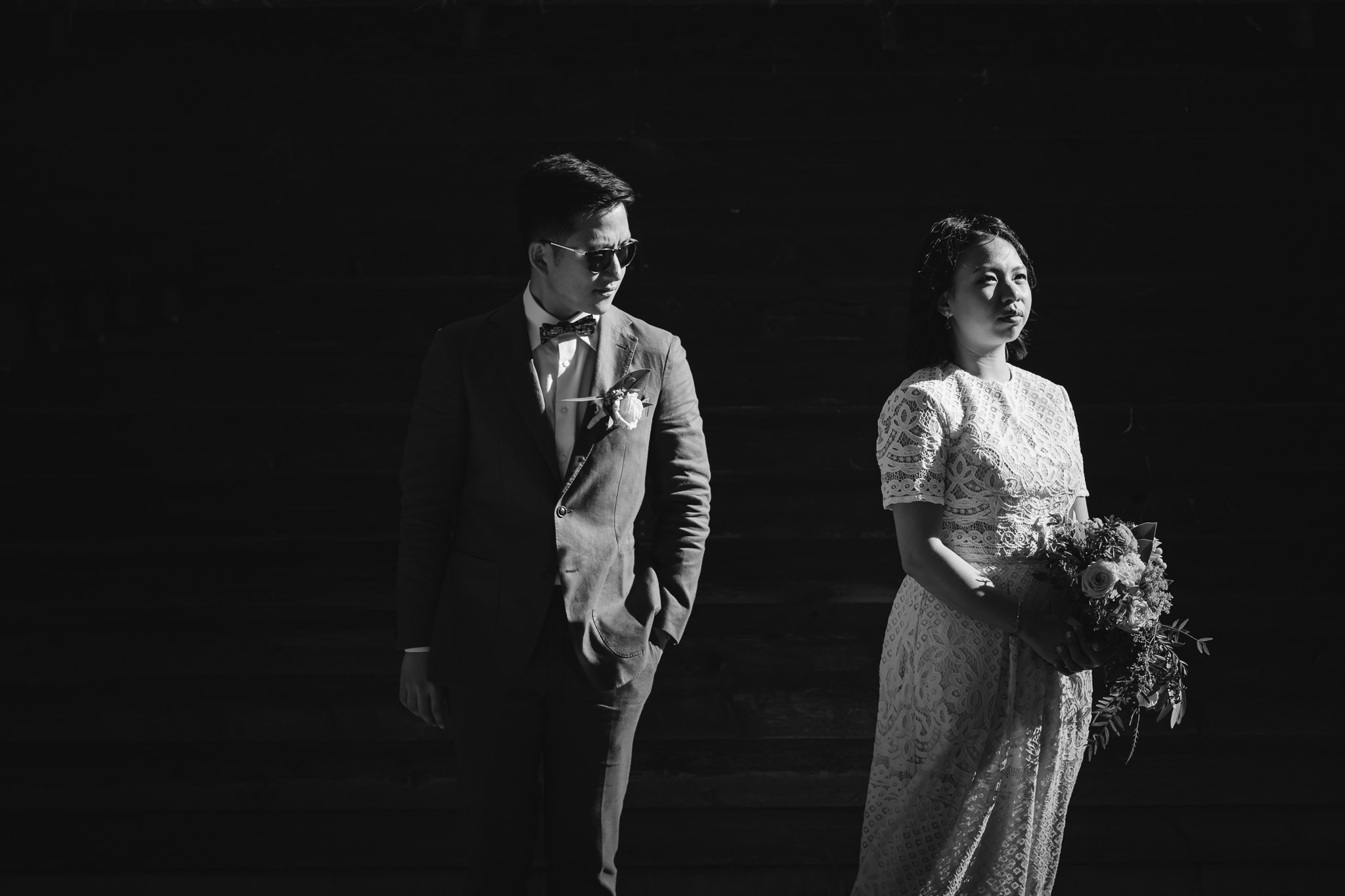 Black and white photo of Singaporean Chinese couple with cool style at Karridale Cottages on their wedding day