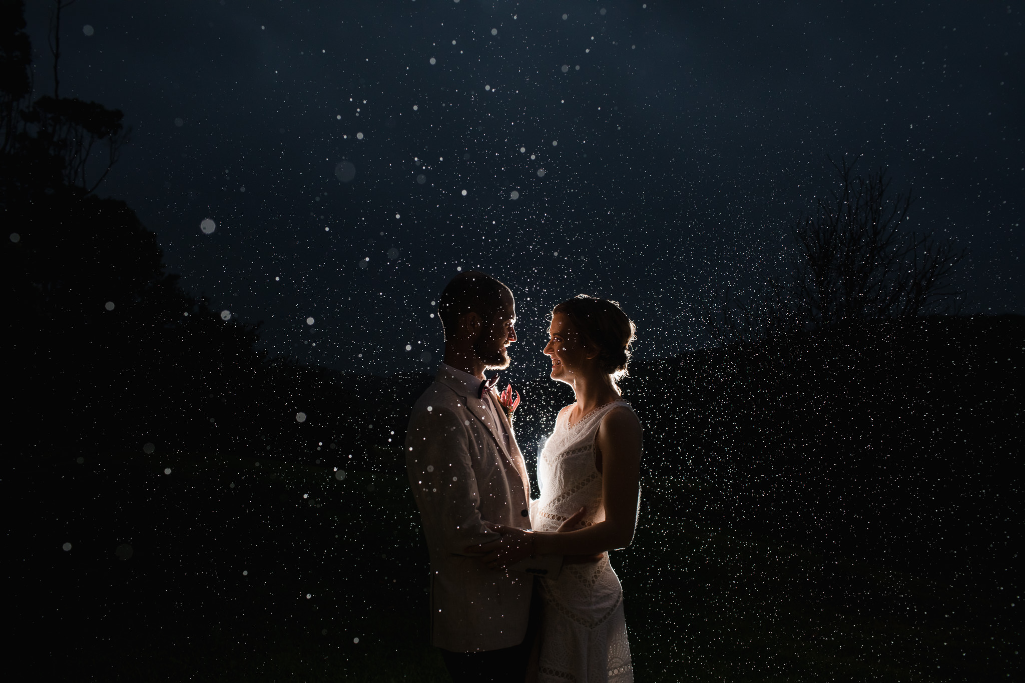 Backlit rain photo of bride and groom at Pearl River Houses in Margaret River on their rainy winter wedding