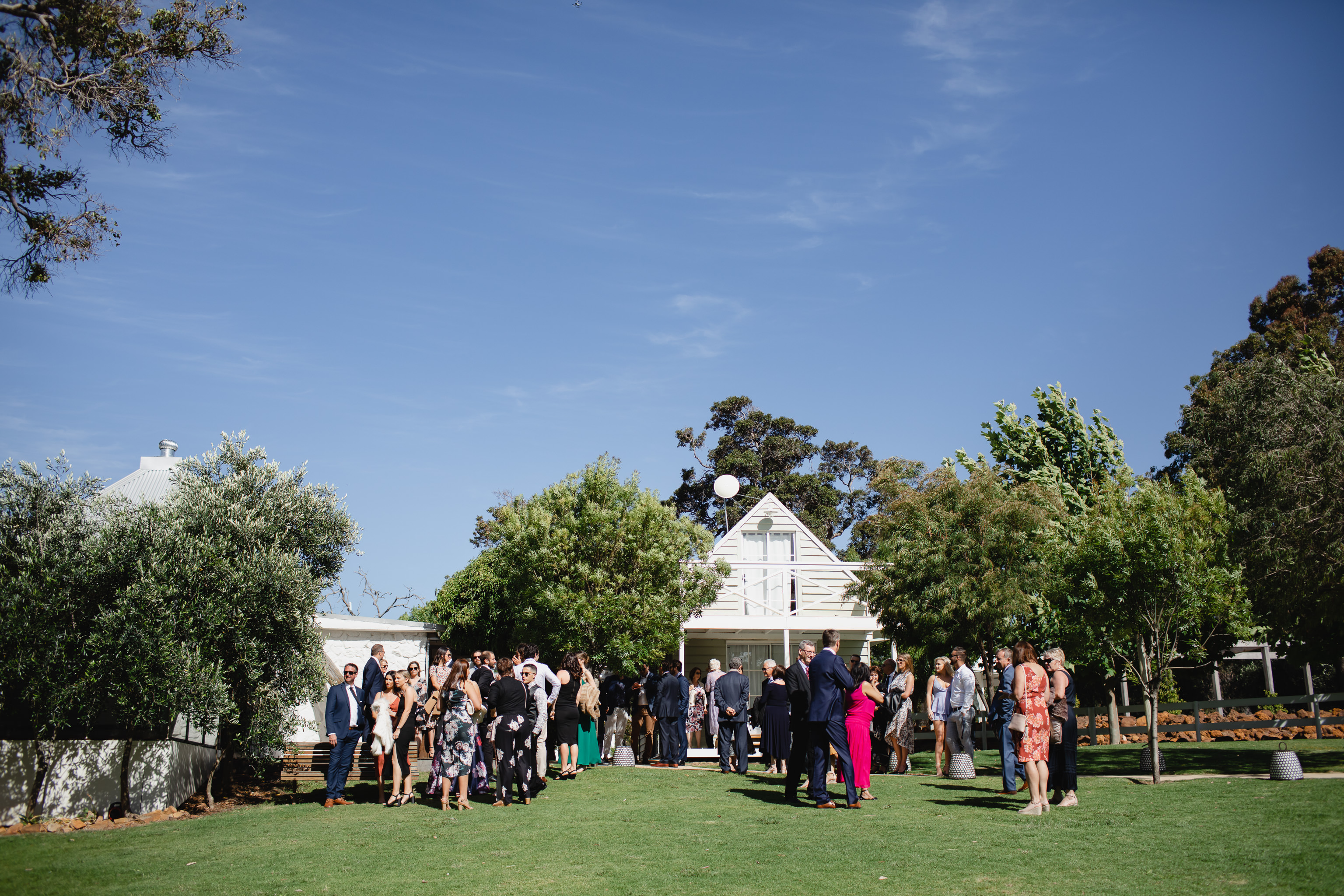 Colour photo of large group of of wedding guests arriving at Meelup Farmhouse near Dunsborough