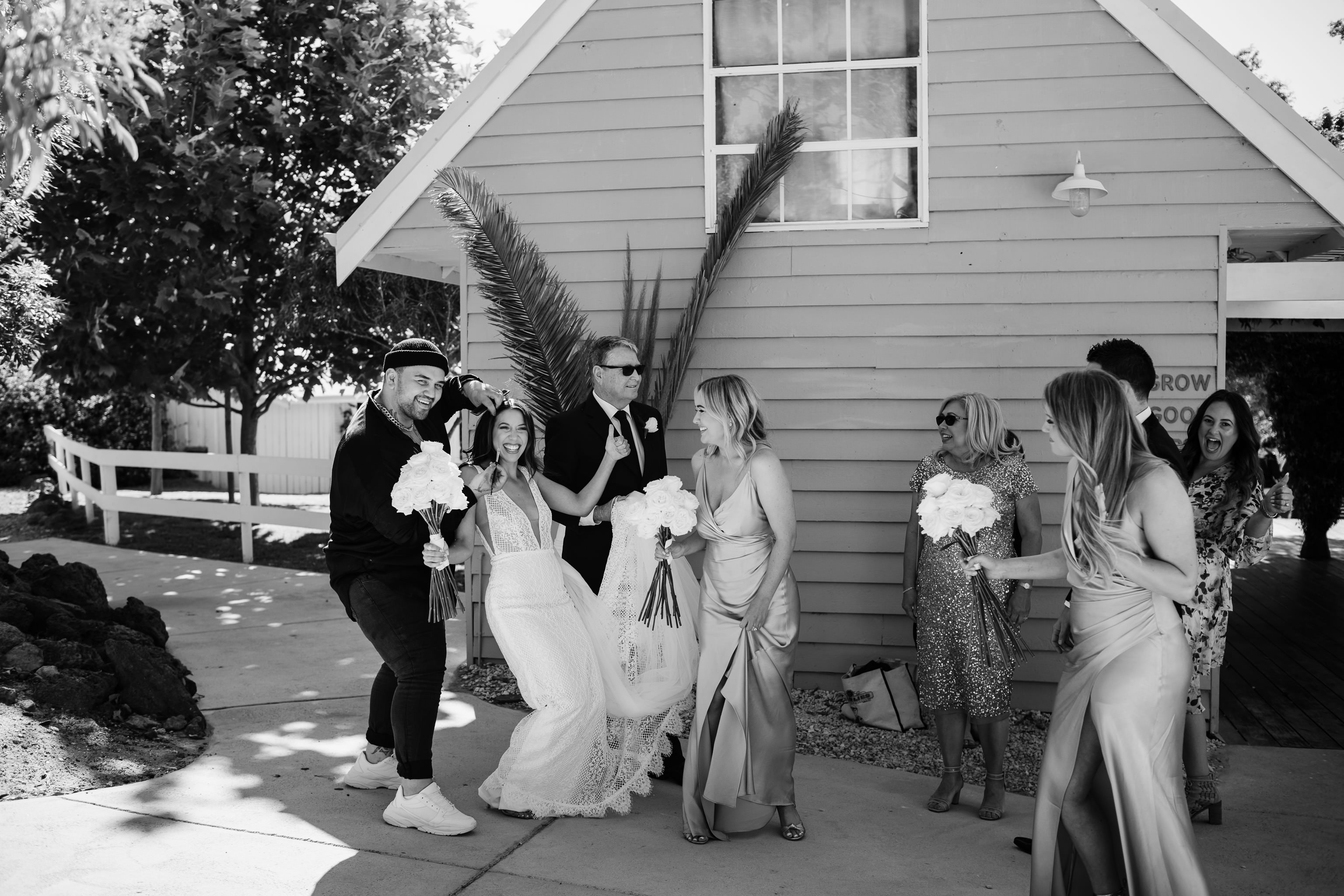 Black and white photo of bride getting final make-up touch ups just before her wedding ceremony at Meelup Farmhouse