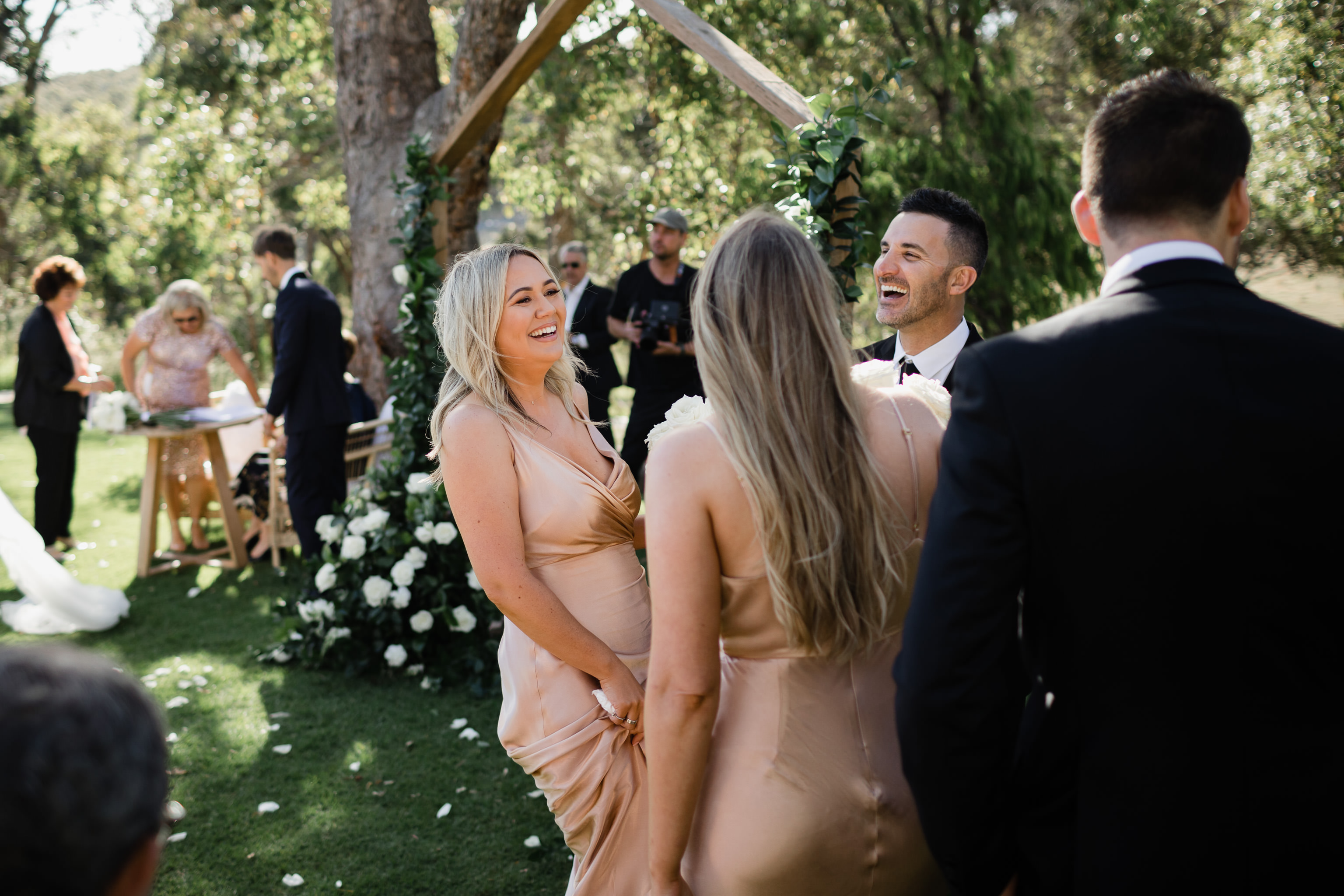Bridesmaid and groomsman laughing during wedding ceremony at Meelup Farmhouse