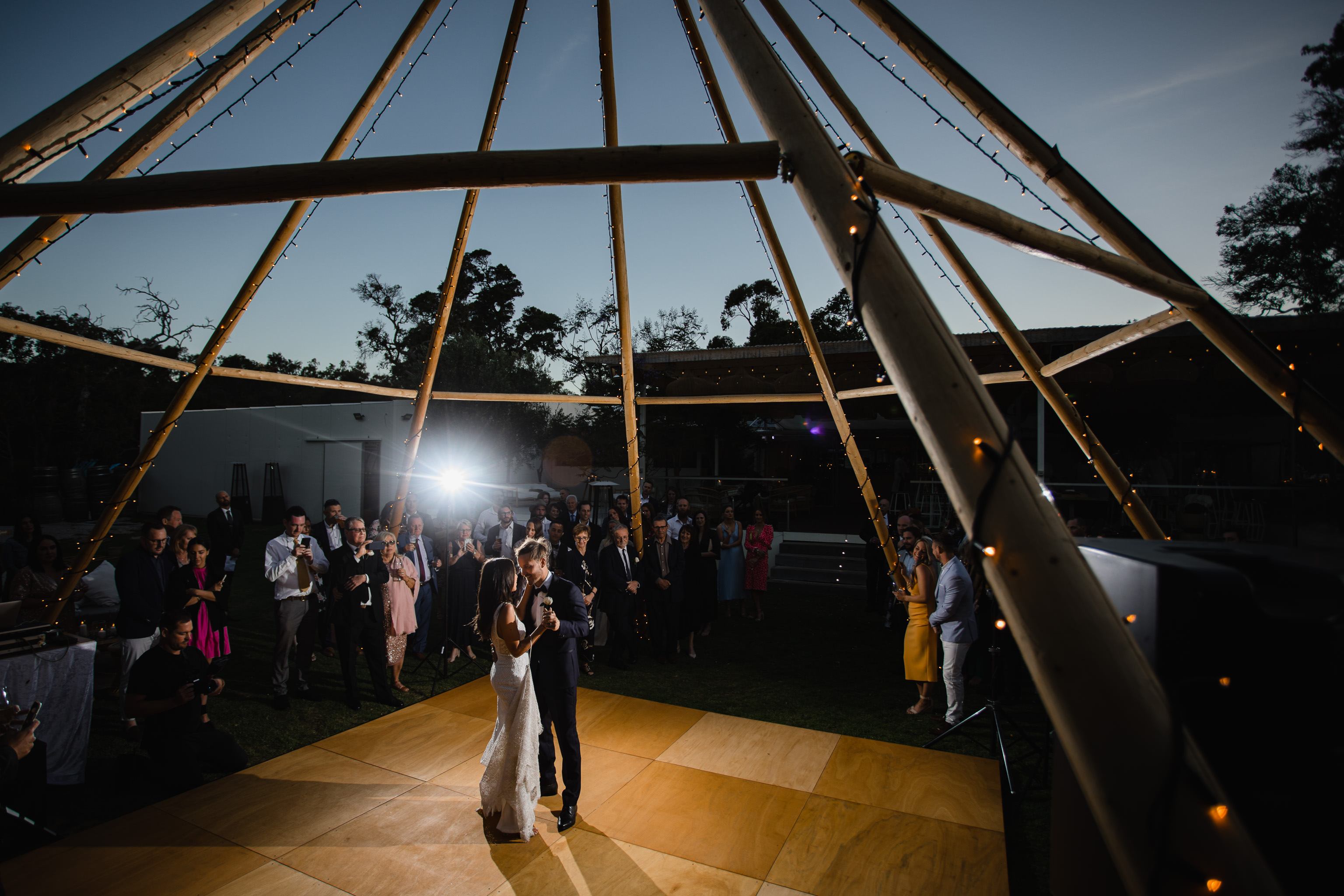 First dance at Meelup Farmhouse wedding under giant naked tipi frame from Yallingup Event Hire
