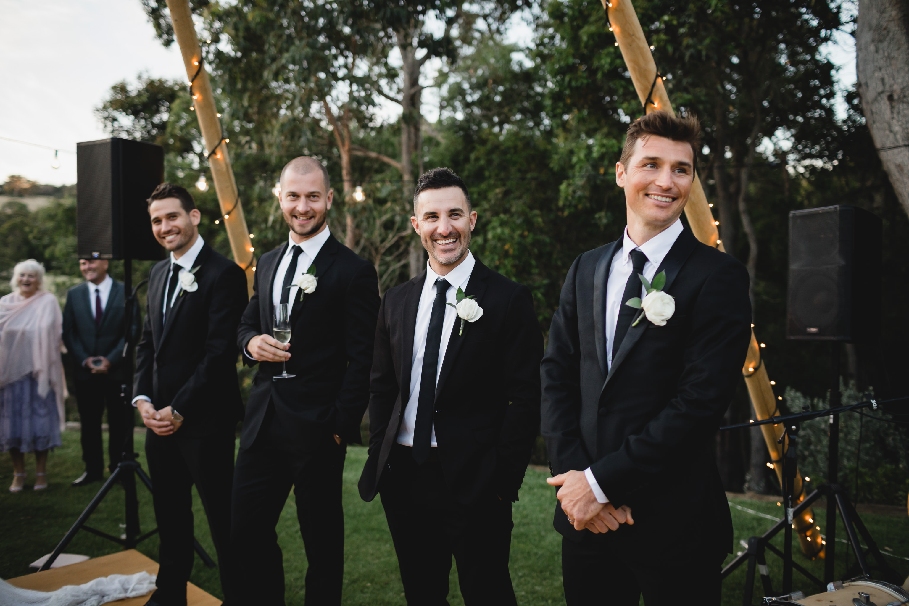 Groomsmen smiling and laughing during wedding speeches at Meelup Farmhouse
