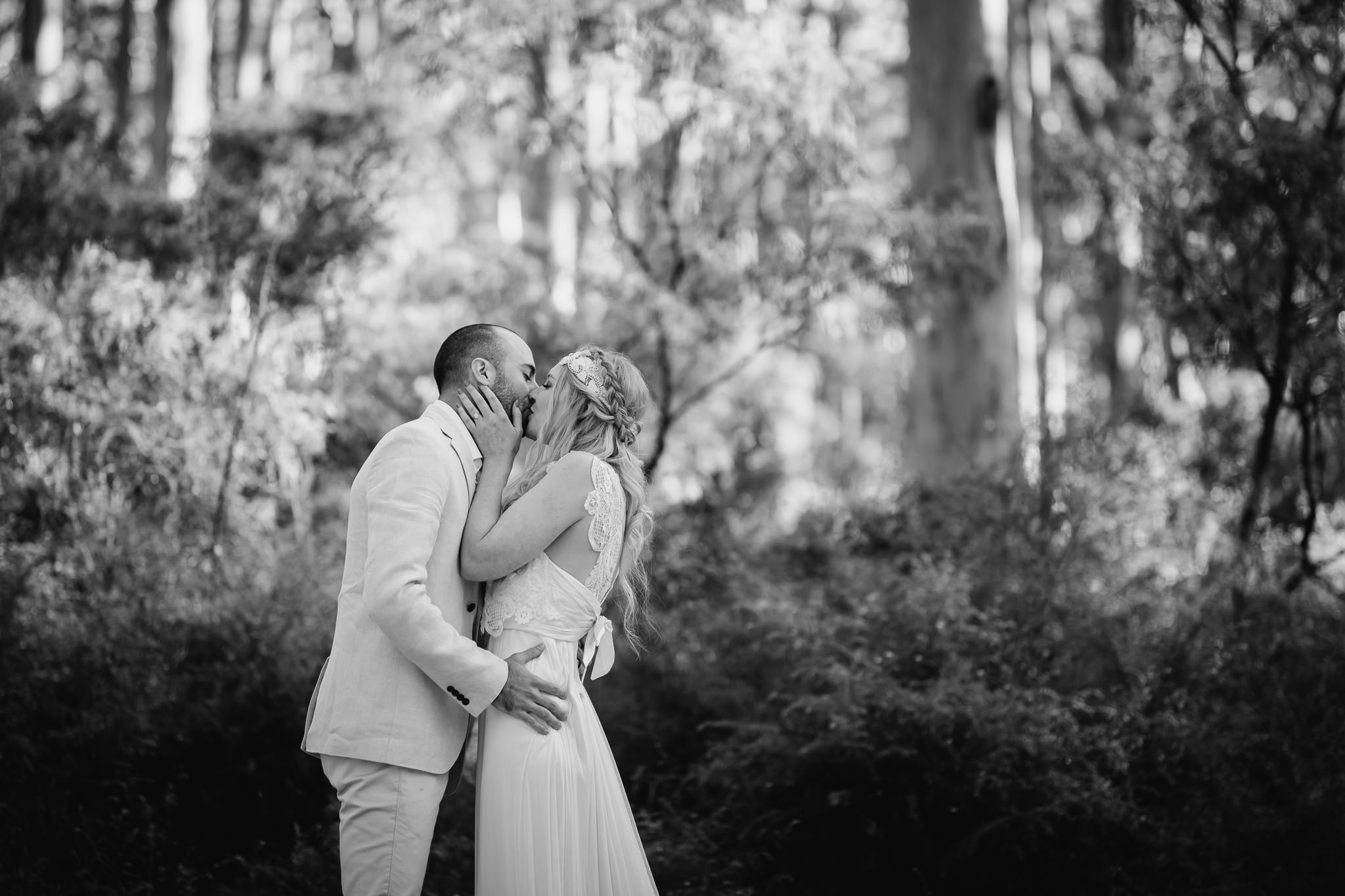 Bride and groom first kiss at forest wedding in Boranup
