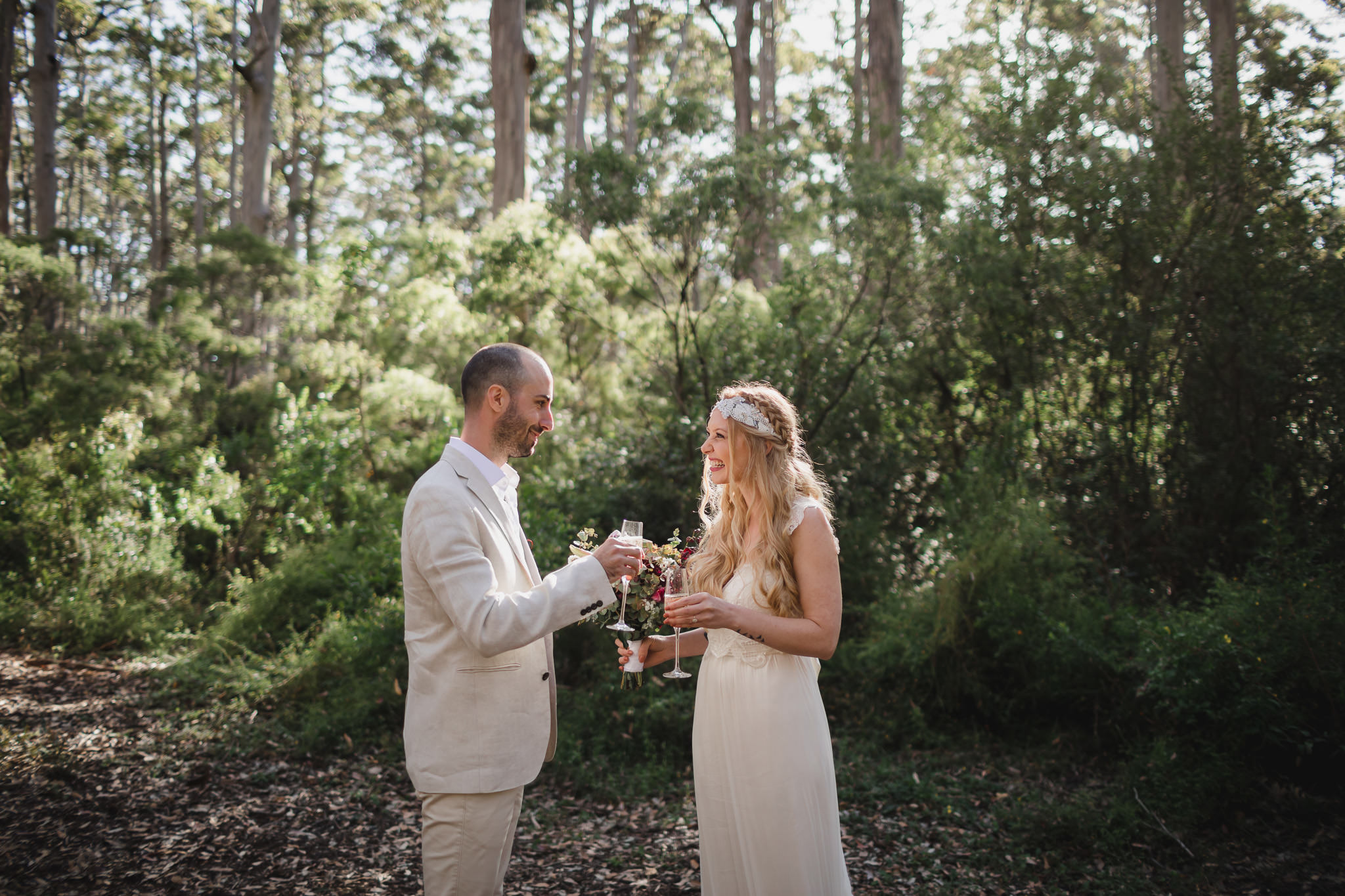 Couple celebrating their wedding with champagne toast in Boranup forest near Margaret River